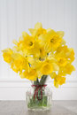 Daffodils In A Vase In Rustic Setting - Vertical Royalty Free Stock Image - 51905156