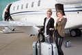 Executive Business Team Leaving Corporate Jet Stock Images - 51907444