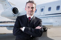 Executive Business Man In Front Of Corporate Jet Stock Image - 51908731