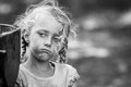 Street Kid - Candid Portrait Of A Little Girl In Black And White Stock Photography - 51912742