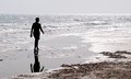 Man Walking Alone  In The Beach Stock Photos - 51928373