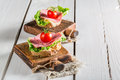 Tasty Salami With Lettuce And Tomato Stock Image - 51951211