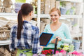 Happy Women With Tablet Pc At Flower Shop Royalty Free Stock Image - 51971076