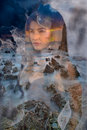 Woman In Fog And Rocks Stock Image - 51973711