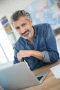 Charming Mature Man Working On Laptop Stock Images - 51975534