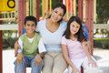 Mother And Children In Playground Stock Photo - 5207350