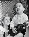Close-up Of A Boy Playing A Guitar With His Sister Royalty Free Stock Images - 52015449