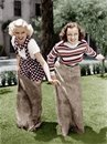 Two Women Playing A Game Of Potato Sack Racing Royalty Free Stock Photography - 52028237