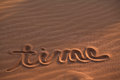 Time Message Drawn In Sand Stock Image - 52051721