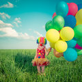 Child With Toy Balloons In Spring Field Royalty Free Stock Photos - 52053808