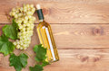 White Wine Bottle And Bunch Of White Grapes Stock Photo - 52054590