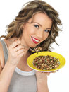 Young Woman Eating A Mixed Bean Salad And Brown Rice Salad Stock Images - 52058094