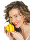 Young Woman Eating A Fresh Ripe Mango Royalty Free Stock Images - 52061739