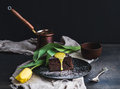 Perfect Morning Set For Woman. Piece Of Truffle Chocolate Cake With Lemon Curd Icing, Hot Coffee And Yellow Tulip On Dark Backdrop Stock Photography - 52063812