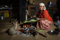 HIMALAYAN VILLAGE, NEPAL - NOVEMBER 24: Woman Cooking Inside Of Traditional House Of Himalayan Village On November 24, 2014 Royalty Free Stock Image - 52064106