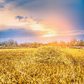Agricultural Landscape With Straw Field And Sunrset Royalty Free Stock Images - 52065639