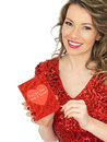Happy Young Woman Holding A Valentines Card Stock Photo - 52071570