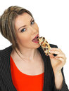 Young Business Woman Eating A Breakfast Cereal Bar Stock Images - 52090314