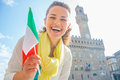 Woman With Flag In Front Of Palazzo Vecchio, Italy Stock Images - 52092114