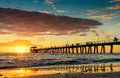 People On The Jetty At Sunset Royalty Free Stock Photography - 52095107