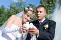 Two Pigeons In Hands Of Newly-married Couple Stock Photo - 5210290