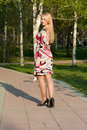 The Beautiful Young Woman Walks On Park. Stock Image - 5212451
