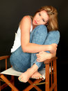 Beautiful Relaxed Young Woman Sitting In A Chair Royalty Free Stock Photography - 52100557