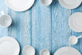 Empty Plates And Bowls On Blue Wooden Background Stock Image - 52102391