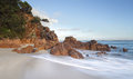 Morning Light Glistens On The Volcanic Rocks At Shoal Bay Royalty Free Stock Photography - 52120267