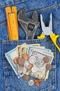 Money And Tool In Jeans Pocket Royalty Free Stock Photo - 52157015