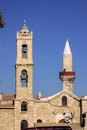 Orthodox Church Bell Tower Next To The Mosque Minaret, Limassol, Cyprus Royalty Free Stock Image - 52190016