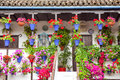 Typical Terrace (balcony) Decorated Pink And Red Flowers, Spain Royalty Free Stock Image - 52217666