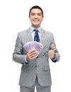 Smiling Businessman With Money Showing Thumbs Up Royalty Free Stock Image - 52228336