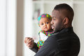 Young African American Father Holding With Her Cute Baby Girl Royalty Free Stock Photos - 52257358