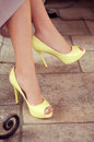 Woman S Legs In Light Yellow Open-toe Pumps. Woman Sitting In A Royalty Free Stock Image - 52260036