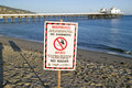 A �Warning - No Swimming� Sign Due To Pollution At A Malibu Beach, Malibu, California Stock Photo - 52267370