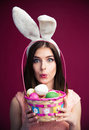 Cute Young Woman With An Easter Egg Basket Stock Images - 52296514