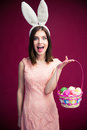 Woman With An Easter Egg Basket Stock Image - 52296551