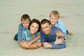 Family Lying On The Sand Royalty Free Stock Image - 52331226