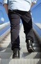 Low Angle Man Standing On Escalator Stock Photo - 52341690