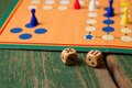 Two Wooden Dices In Front Of Ludo With Figurines Royalty Free Stock Photo - 52348365
