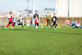 Blur Of Boys Playing Soccer Royalty Free Stock Images - 52371549
