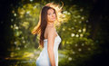 Beautiful Young Woman Posing In A Summer Meadow. Portrait Of Attractive Brunette Girl With Long Hair Relaxing In Nature, Outdoor Royalty Free Stock Images - 52379619