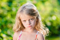 Close-up Portrait Of Sad Blond Little Girl With Pursed Lips Stock Image - 52401921