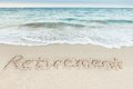 Retirement Written On Sand By Sea Royalty Free Stock Photo - 52412425