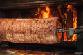 Turkish Doner Kebab Is Preparing In An Oven With Open Fire Royalty Free Stock Image - 52415826