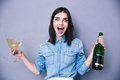 Woman Holding Two Glass And Bottle Of Champagne Stock Photos - 52417133