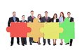 Confident Businesspeople Joining Jigsaw Puzzle Pieces Royalty Free Stock Photos - 52420378