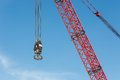 Red Crane Boom With Hook Against Blu Sky Stock Photo - 52428130