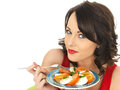 Healthy Young Woman Eating A Mozzarella Cheese And Tomato Salad Stock Images - 52432184